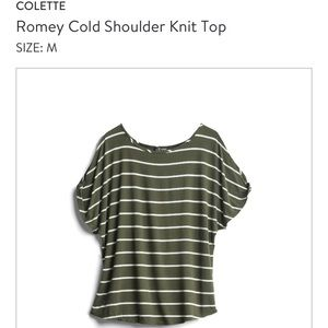 Knit top with sleeve cut outs.